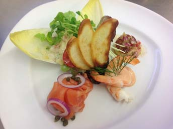 "Mixed Seafood Plate served with selection of smoked, cooked and grilled Seafood ""Salmon, King Prawns and Scallops"" served on warm Creamed Potato Salad"